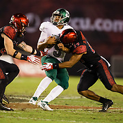 22 September 2018: San Diego State Aztecs safety Tariq Thompson (14) tackles Eastern Michigan Eagles quarterback Mike Glass III (9) on quarterback keeper in the third quarter. The San Diego State Aztecs beat the Eastern Michigan Eagles 23-20 in over time at SDCCU Stadium in San Diego, California.