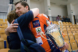 Andrej Flajs of ACH with a Trophy and his mother at final match of Slovenian National Volleyball Championships between ACH Volley Bled and Salonit Anhovo, on April 24, 2010, in Radovljica, Slovenia. ACH Volley defeated Salonit 3rd time in 3 Rounds and became Slovenian National Champion.  (Photo by Vid Ponikvar / Sportida)