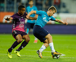 August 24, 2017 - Saint Petersburg, Russia - Oleg Shatov (R) of FC Zenit Saint Petersburg and Urby Emanuelson of FC Utrecht vie for the ball during the UEFA Europa League play-off round second leg match between FC Zenit St. Petersburg and FC Utrecht at Saint Petersburg Stadium on August 24, 2017 in Saint Petersburg, Russia. (Credit Image: © Mike Kireev/NurPhoto via ZUMA Press)