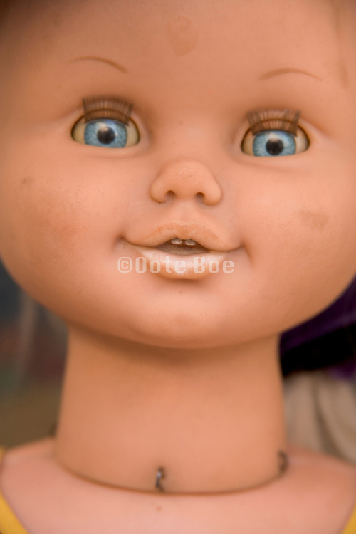 close up of a baby doll face
