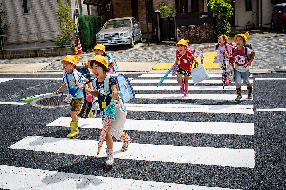 School children cross a street in Nagoya, Japan.
