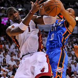 Jun 17, 2012; Miam, FL, USA; Miami Heat power forward Chris Bosh (1) and Oklahoma City Thunder point guard Russell Westbrook (0) battle for possession during the second quarter in game three in the 2012 NBA Finals at the American Airlines Arena. Mandatory Credit: Derick E. Hingle-US PRESSWIRE