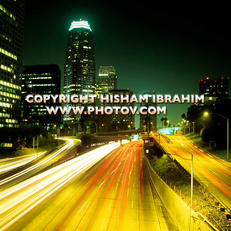 Los Angeles skyline, Harbor Freeway and Downtown District at night, California, USA.