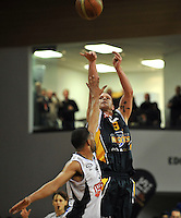 Hayden Allen takes a shot, in the NBL match, between the Otago Nuggets and Hawkes Bay, Lion Foundation Arena, Edgar Centre, Dunedin, Otago, New Zealand, Friday, May 24, 2013. Credit: Joe Allison / Allison Images.