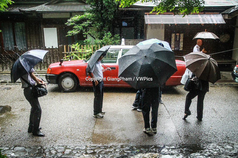 Students waiting under the rain in Kyoto Prefectures, Japan