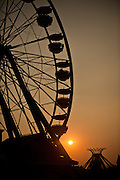 The Ferris Wheel is silhouetted during Sunset at Family Kingdom amusement park along the beachfront in Myrtle Beach, SC.