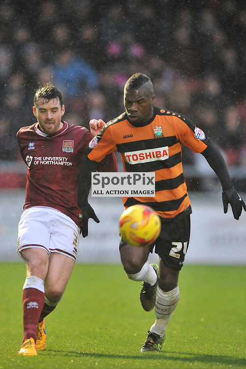 Northamptons Brendan Moloney holds of Barnets Aaron McLean, Northampton Town v Barnet FC, Sixfields Stadium, Sky Bet League Two, Saturday 2nd January 2016