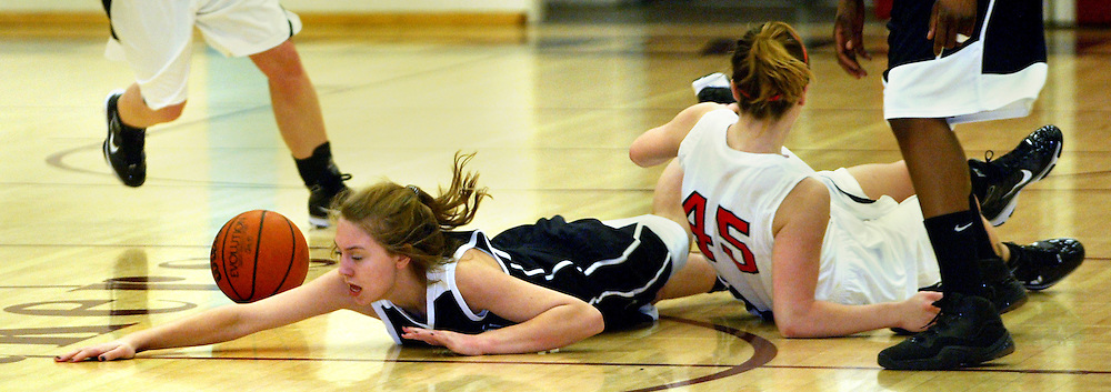 01/07/2010 - Wilson's Tessa Peterson (44) dives for a loose ball past Franklin's Kristin Swim (45).  Franklin beat Wilson 75-51.