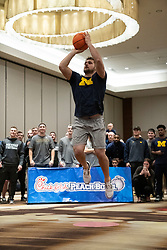 "The Michigan Wolverines participate in the ""Battle for Bowl Week"" Basketball Challenge on Tuesday, December 25, 2018, in Atlanta. ""Battle for Bowl Week"" consists of a series of events that each team participates in, with the overall winning team taking home the ""Battle for Bowl Week"" belt; Michigan will face Florida in the 2018 Chick-fil-A Peach Bowl NCAA football game on December 29, 2018. (Paul Abell via Abell Images for the Chick-fil-A Peach Bowl)"