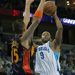 05 October 2008:  New Orleans Hornets guard Morris Peterson (9) shoots over Golden State Warriors center Andris Biedrins (15) during a NBA preseason game between the Golden State Warriors and the New Orleans Hornets at at the New Orleans Arena in New Orleans, LA..
