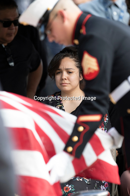 Rebecca Flores mourns the passing of husband Maximo Flores at SunWest Cemetery on August 3, 2019 in El Mirage, AZ