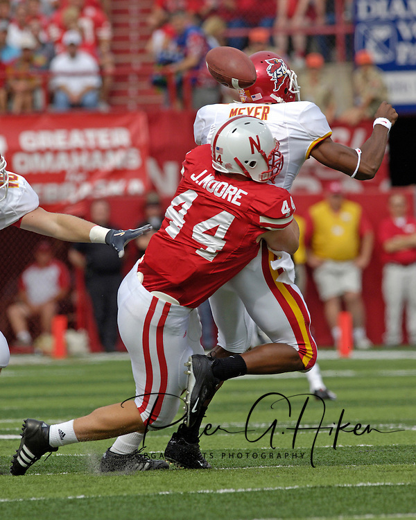 Iowa State quarterback Bret Meyer (7) fumbles the ball after getting hit from behind by Nebraska defensive end Jay Moore (44) during the first quarter, at Memorial Stadium in Lincoln, Nebraska, Oct. 1, 2005.