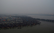 Feb. 8, 2016 - Allahabad, India - <br /> <br /> Millions of Indian Hindu devotees walk across a pontoon bridge at the Sangam, the confluence of the Ganges, Yamuna and the mythical Saraswati as others take a holy dip, on the occasion of ''Mauni Amavasya'' or new moon day,during a foggy morning, in Allahabad, on February 8,2016. Mauni Amavasya is considered the most auspicious date of bathing during the annual month long ''Magh Mela'' religious fair. ©Exclusivepix Media