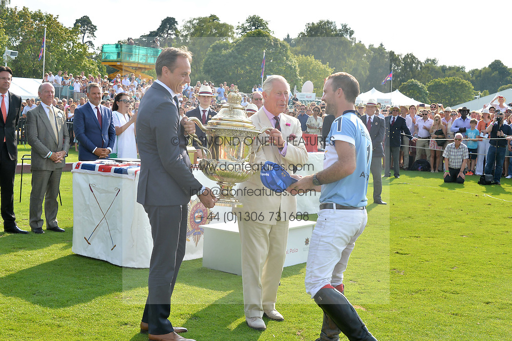 Left to right, ANDRE KONSBRUCK Director of Audi UK and HRH THE PRINCE OF WALES present the Coronation Cup to FACUNDO PIERES at the Audi International Polo at Guards Polo Club, Windsor Great Park, Egham, Surrey on 26th July 2014.