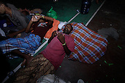 "ACEH, INDONESIA - MAY 12: <br /> <br /> Hundreds of Rohingya Muslim refugees rescued from boats off Indonesia<br /> <br /> Almost 900 men, women and children have been rescued from boats off the coast of Aceh, Indonesia in just two days, according to local officials.<br /> <br /> Fishermen spotted the first group of 547 people early on Sunday morning, according to Tegas, an officer at the North Aceh Immigration Office, where they're being processed.<br /> <br /> ""They (refugees) were drifting out at sea for a days, maybe even longer, without food and water. Many of them are weak and depressed. There a number of very young children too,"" said Tegas, who only uses one name.<br /> <br /> The rescued migrants are staying in several shelters while they undergo immigration, health and security checks. The local government was providing food and water, but Tegas said shelters were becoming overcrowded and supplies were being stretched thin.<br /> <br /> ""We're doing the best we can but we have limited supplies too and this is creating tension among them,"" he said.<br /> <br /> Found at sea<br /> The first group of migrants was found traveling in six boats off the Aceh coast, near the city of Lhokseumawe, said Budiawan, the head of the Aceh Search and Rescue Agency.<br /> <br /> He said another boat carrying around 400 people was spotted around 2 a.m. local time on Monday, further north along the coast. ""We sent teams there to help evacuate the people off the boat,"" Budiawan said. He said it wasn't clear where they were heading.<br /> <br /> The International Organization for Migration has sent staff to Aceh to care for the migrants and learn where they came from and why.<br /> <br /> ""It is a mixed group Rohingya and Bangladeshi as far as we can tell now. We have staff with relevant language skills in the visiting IOM group, so will hopefully get better information in the coming hours,"" said Steve Hamilton, IOM Deputy Chief of Mission in Indonesia.<br /> <br /> Rohingya have been fleeing Myanmar, also know as Burma, in the thousands, amid what's been described as the ethnic cleansing of the minority Muslims"