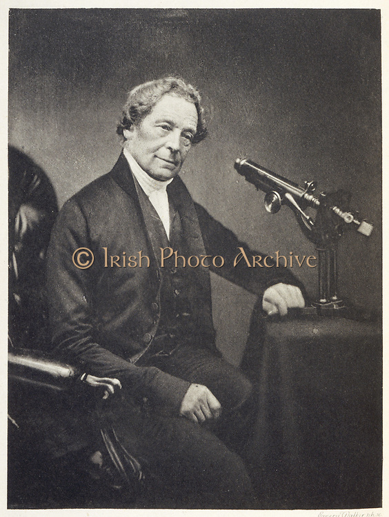 Joseph Jackson Lister (1786-1869) English physicist and opticist who made important improvements to the microscope.  On the table beside him is his improved microscope (1828) which had a pefectly achmatic combination of lenses.  Father of the surgeon Joseph Lister.  Photogravure.