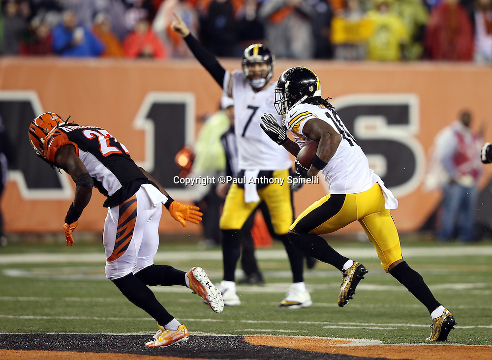 Pittsburgh Steelers quarterback Ben Roethlisberger (7) points in the background while Pittsburgh Steelers wide receiver Martavis Bryant (10) runs a third quarter reverse for a gain of 44 yards and a first down at the Cincinnati Bengals 20 yard line during the NFL AFC Wild Card playoff football game against the Cincinnati Bengals on Saturday, Jan. 9, 2016 in Cincinnati. The Steelers won the game 18-16. (©Paul Anthony Spinelli)