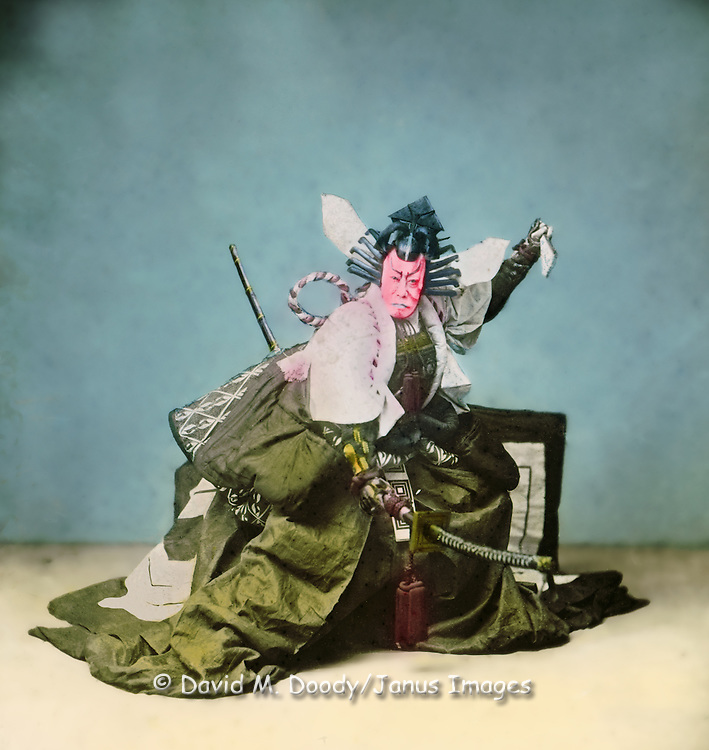 Japanese Samurai Warrior, possibly in Kabuki play. Photo circa 1900 from a hand tinted glass lantern slide.