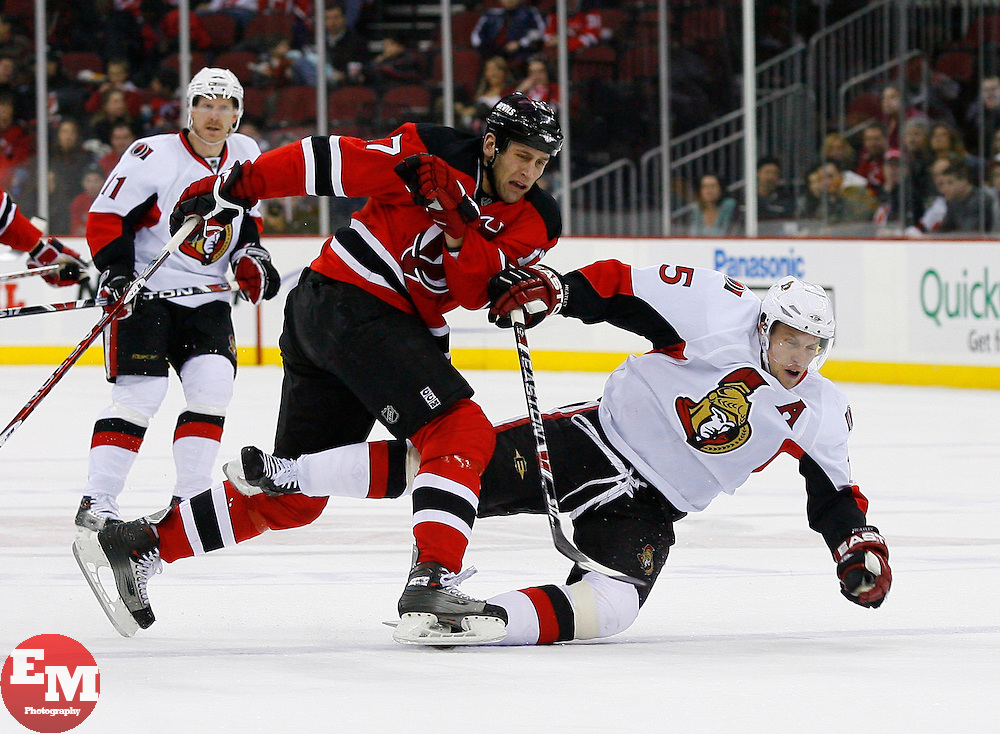 Jan 4, 2008; Newark, NJ, USA; New Jersey Devils left wing Mike Rupp (17) hits Ottawa Senators left wing Dany Heatley (15) during the first period at the Prudential Center.