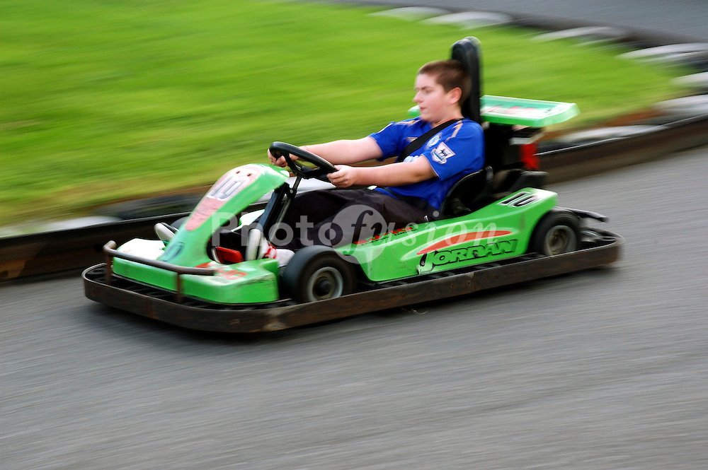 Boy driving go-kart UK