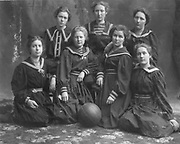 1900 Girls  intercollegiate basketball squad at the University of Washington. From left, top row, Winifred McGrath, Jessie Barlow, Pearl McDonnell; bottom row, Stella Brintnall, Blanche Winsor, Ann Mitchell, Bess McDonnell. (The Seattle Times archives)