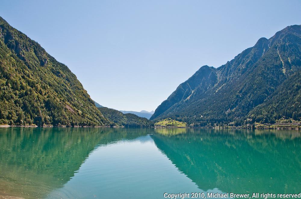 The beautiful blue lake at Le Prese, Graubunden, Switzerland.