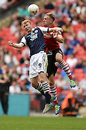 Chris Taylor of Millwall looks to win a header in the air against Marc Roberts of Barnsley during the Sky Bet League 1 Play-off Final between Barnsley and Millwall at Wembley Stadium, London<br /> Picture by Richard Blaxall/Focus Images Ltd +44 7853 364624<br /> 29/05/2016