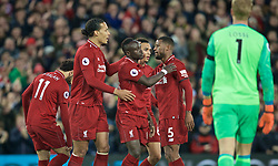 LIVERPOOL, ENGLAND - Friday, April 26, 2019: Liverpool's Sadio Mane celebrates scoring the second goal with team-mates during the FA Premier League match between Liverpool FC and Huddersfield Town AFC at Anfield. (Pic by David Rawcliffe/Propaganda)