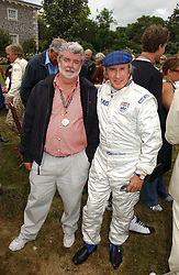 "Left to right, GEORGE LUCAS and SIR JACKIE STEWART at the Goodwood Festival of Speed on 9th July 2006.  Cartier sponsored the ""Style Et Luxe' for vintage cars on the final day of this annual event at Goodwood House, West Sussex and hosted a lunch.<br />