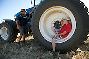 10 year old James Reilly, with his father, Marcus Reilly, takes a rest after helping out on the farm after school. Wyalkatchem, Western Australian Wheatbelt. 10 December 2012 - Photograph by David Dare Parker
