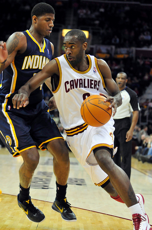 Feb. 2, 2011; Cleveland, OH, USA; Indiana Pacers small forward Paul George (24) tries to stop Cleveland Cavaliers guard Christian Eyenga (8) during the second quarter at Quicken Loans Arena. Mandatory Credit: Jason Miller-US PRESSWIRE