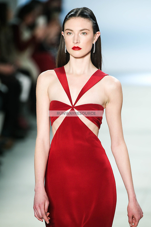 Jacquelyn Jablonski walks the runway wearing Cushnie et Ochs Fall 2016, hair by Antonio Corral Calero for Moroccanoil, makeup by Val Garland, photographed by Thomas Concordia during New York Fashion Week on February 12, 2016