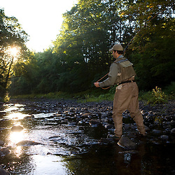 A man fly-fishing on the Isinglass River in Barrington, New Hampshire.