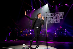 Olly Murs performing on stage at the Royal Albert Hall in London for the Teenage Cancer Trust annual concert series.