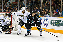 December 13, 2010; San Jose, CA, USA;  San Jose Sharks right wing Ryane Clowe (29) is defended by Dallas Stars defenseman Trevor Daley (6) during the first period at HP Pavilion. Mandatory Credit: Jason O. Watson / US PRESSWIRE
