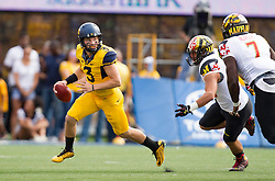 Sep 26, 2015; Morgantown, WV, USA; West Virginia Mountaineers quarterback Skyler Howard runs out of the pocket against the Maryland Terrapins during the first quarter at Milan Puskar Stadium. Mandatory Credit: Ben Queen-USA TODAY Sports