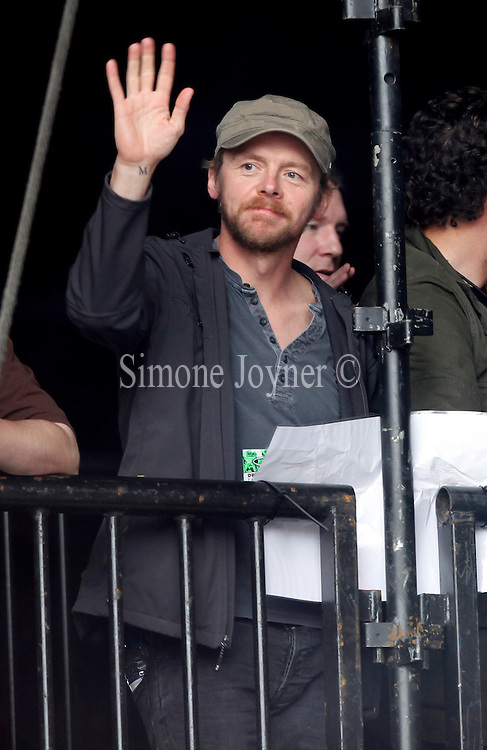 READING, ENGLAND - AUGUST 26:  Simon Pegg is watches the Black Keys at the Main Stage on Day Three during the Reading Festival 2012 at Richfield Avenue on August 26, 2012 in Reading, England.  (Photo by Simone Joyner/Getty Images)