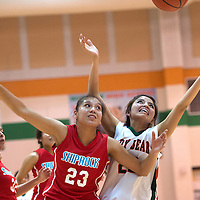 020315      Cayla Nimmo<br /> <br /> Shiprock Lady Chieftain Tanisha Begay (23) and Wingate Lady Bear Brittany Payton (22) reach for a rebounded ball during the Tuesday night game in Wingate.
