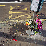 A memorial has been placed where an unknown person died at Beulah Hill, London, England, UK. If we drove past this place where someone's life ended, the victim would just be an anonymous statistic but flowers are left to die too and touching poems and dedications are written by family and loved-ones. From a project about makeshift shrines: Britons have long installed memorials in the landscape: Statues and monuments to war heroes, Princesses and the socially privileged. But nowadays we lay wreaths to those who die suddenly - ordinary folk killed as pedestrians, as drivers or by alcohol, all celebrated on our roadsides and in cities with simple, haunting roadside remembrances.