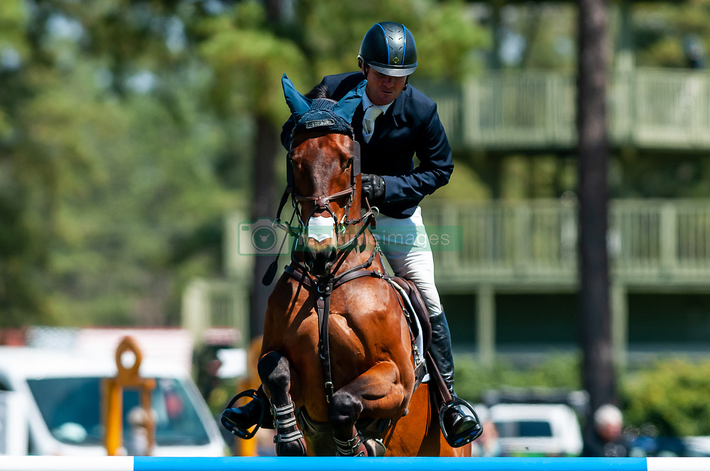 March 22, 2019 - Raeford, North Carolina, US - March 22, 2019 - Raeford, N.C., USA - PHILLIP DUTTON of the United States riding FERNHILL SINGAPORE  competes in the show jumping CCI-4S division at the sixth annual Cloud 11-Gavilan North LLC Carolina International CCI and Horse Trial, at Carolina Horse Park. The Carolina International CCI and Horse Trial is one of North AmericaÃ•s premier eventing competitions for national and international eventing combinations, hosting International competition at the CCI2*-S through CCI4*-S levels and National levels of Training through Advanced. (Credit Image: © Timothy L. Hale/ZUMA Wire)