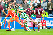 Scott Sinclair(#11) of Celtic FC holds off Jimmy Dunne (#3) of Heart of Midlothian and Zdenek Zlamal (#1) of Heart of Midlothian during the Betfred League Cup semi-final match between Heart of Midlothian FC and Celtic FC at the BT Murrayfield Stadium, Edinburgh, Scotland on 28 October 2018.