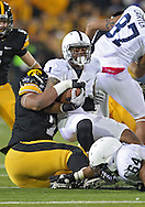 October 20 2012: Penn State Nittany Lions running back Bill Belton (1) is brought down by Iowa Hawkeyes defensive lineman Dominic Alvis (79) during the second half of the NCAA football game between the Penn State Nittany Lions and the Iowa Hawkeyes at Kinnick Stadium in Iowa City, Iowa on Saturday October 20, 2012. Penn State defeated Iowa 38-14.