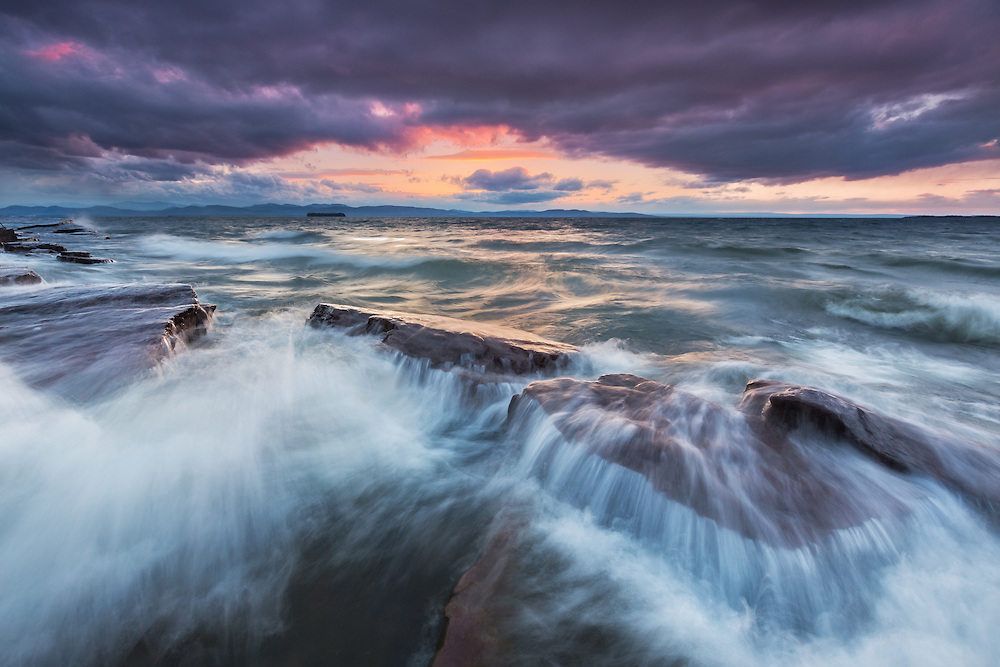 Crashing waves and dramatic skies over Lake Champlain, near Burlington, Vermont.