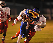 Oxford High's Joey Walden (85) is tackled by Jackson Provine's Chris Shannon in MHSAA football playoff action in Oxford, Miss. on Friday, November 9, 2012.