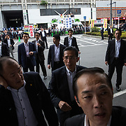 """TOKYO, JAPAN - JULY 1: Prime minister's security members were alerted when anti-Abe protesters suddenly gathers in front of an election campaign of main opposition, Liberal Democratic Party (LDP) in Akihabara, Tokyo, Japan on July 1, 2017. During the election campaign for Tokyo Metropolitan Assembly, anti-Abe protesters chant with their placards """"Abe wa Yamero!"""" """"Resign Prime Minister Abe!"""" during the campaign speech of PM Shinzo Abe for his candidate Aya Nakamura. (Photo: Richard Atrero de Guzman/NUR Photo)"""