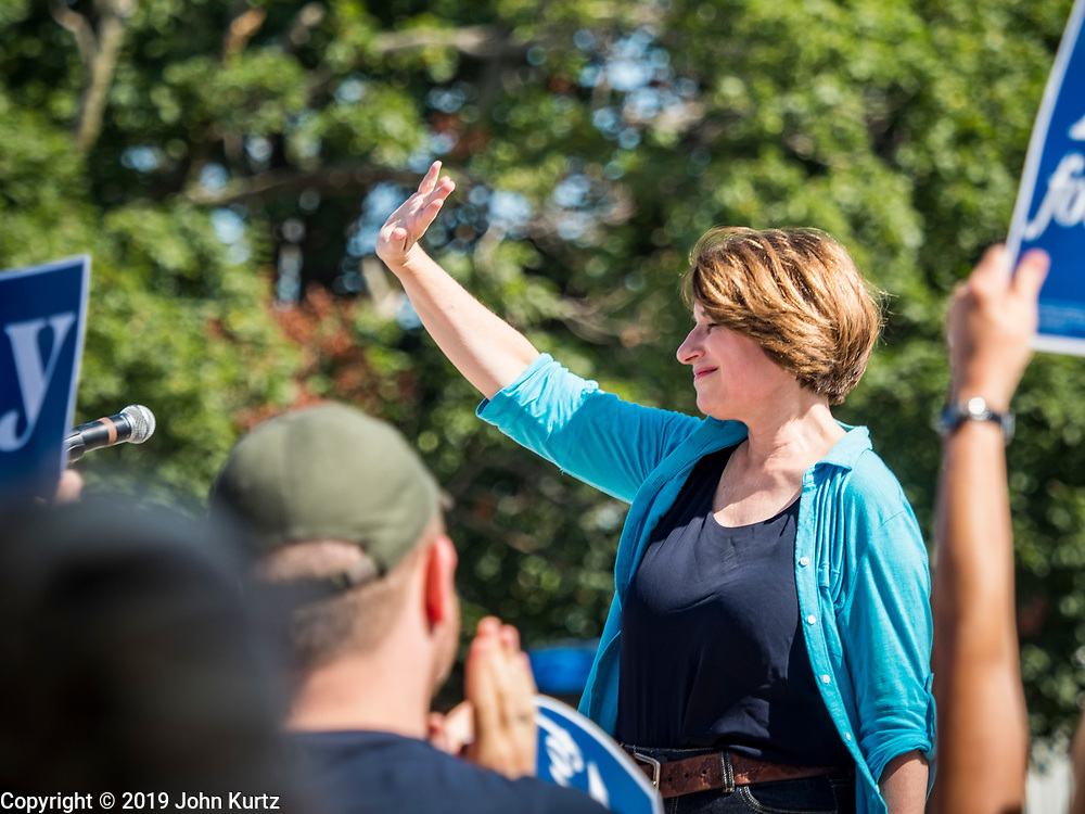 07 AUGUST 2019 - ANKENY, IOWA: Senator AMY KLOBUCHAR (D- MN) waves to the crowd after outlining her plan to revitalize rural America in Ankeny. Sen. Klobuchar announced the plan during an appearance at the Griffieon Family Farm in Ankeny, about 20 miles north of Des Moines. She is campaigning in Iowa, including a stop at the Iowa State Fair, to support her bid to be the Democratic nominee for the US Presidency. Iowa holds the first Presidential selection event of the 2020 election cycle. The Iowa caucuses are scheduled for February 3, 2020.            PHOTO BY JACK KURTZ