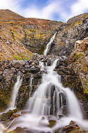 Long exposure of waterfall in Palmer Creek Valley in Southcentral Alaska. Fall. Afternoon.