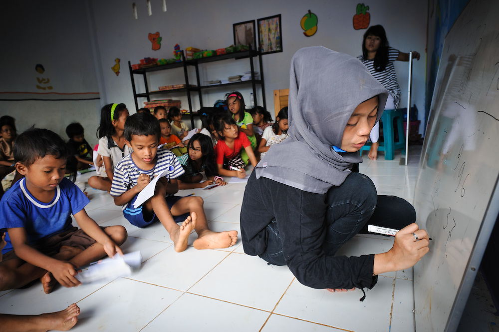 Volunteer teacher at the school supported by Sacred Childhoods Foundation, Makassar, Sulawesi, Indonesia.