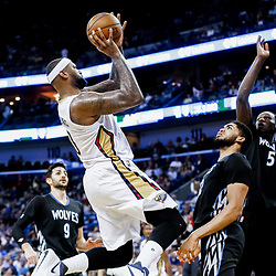 Mar 19, 2017; New Orleans, LA, USA; New Orleans Pelicans forward DeMarcus Cousins (0) shoots over Minnesota Timberwolves center Karl-Anthony Towns (32) and forward Gorgui Dieng (5) during the second half of a game at the Smoothie King Center. The Pelicans defeated the Timberwolves 123-109. Mandatory Credit: Derick E. Hingle-USA TODAY Sports