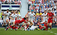 Jack Nowell of England goes past Leigh Halfpenny of Wales during the RBS 6 Nations match at Twickenham Stadium, Twickenham<br /> Picture by Andrew Tobin/Focus Images Ltd +44 7710 761829<br /> 09/03/2014